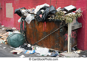 Trash Dumpster in Slums - overfilled trash dumpster in...