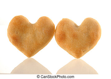 Heart cookies couple with reflection.