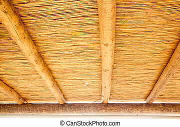 Cane sunroof with round wood beams in yellow golden color