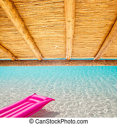 Cane sunroof with tropical perfect beach and  pink float