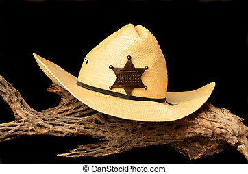 Hat and Badge - Cowboy hat and sheriff's badge isolated over...