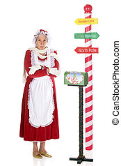 Freezing at the North Pole - Mrs Claus shivering by a...