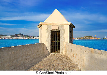Ibiza watchtower with Eivissa port view