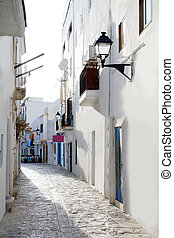 Ibiza downtown white houses narrow street in Mediterranean...