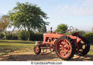 Red tractor - Old red tractor used for agricultural work in...