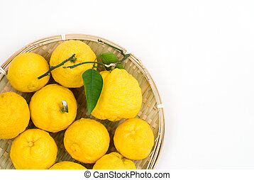 Yellow small citrus (Yuzu) on the bamboo sieve