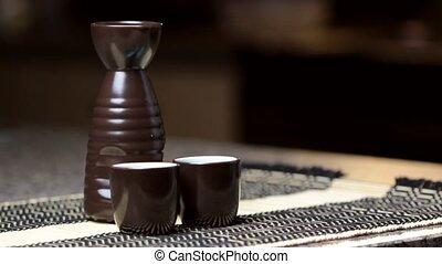 Pouring Saki liquor