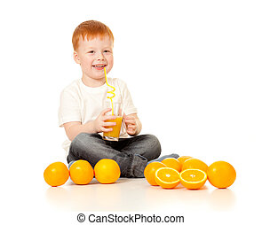 red-haired boy with ornage juice and oranges isolated on white