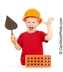 Boy in hard hat with trowel and brick isolated