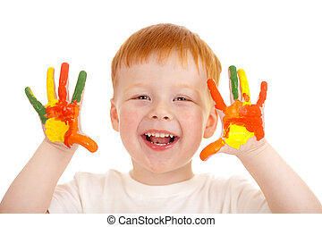 Adorable red-haired boy with hands painted in bright colors isolated on white
