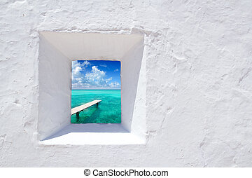 Ibiza mediterranean white wall window with Formentera beach...