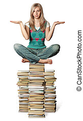 woman in lotus pose balancing on pile of books isolated on...