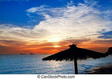 Ibiza sunset in cala Conta Conmte beach with sunroof...