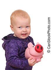 Toddler with piggybank