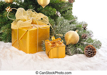 golden Christmas on snow - gold Christmas gift boxes under...