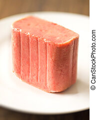 close up of a slab of spam on a plate