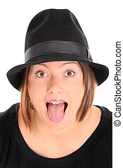Sticking out tongue - A portrait of a pretty young woman in...