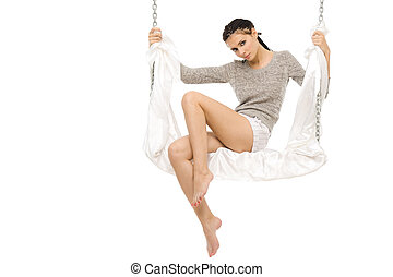Beautiful woman swinging on a swing.