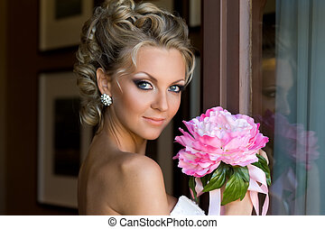 Beautiful bride with bunch of flowers. - Beautiful bride is...