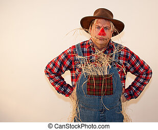 Frowning scarecrow with his hands on his hips.