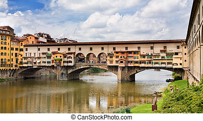 Ponte Vecchio in Florence, Italy - Famous medieval bridge in...