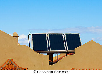 sun electric panels on the roof of house