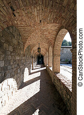 Stone Corridor - A stone corridor leading one around a...