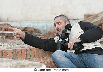 Photographer in a dangerous situation. - War photojournalist...
