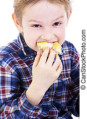 Boy eating healthy sandwich on white background