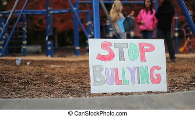 Students With Anti-Bullying Sign - A group of students stand...