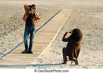 Her favourite model - Woman taking photographs of a teenager...