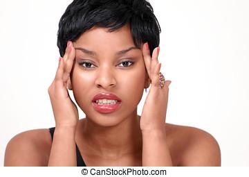 Pretty girl with headache and stress