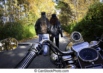 Bikers Couple Walk - Biker couple parks the motorcycle and...