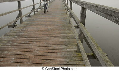bicyclists on the wooden bridge - bicyclists on the wooden...