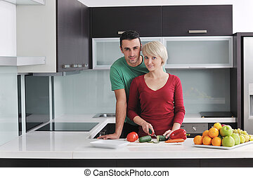 young couple have fun in modern kitchen - happy young couple...