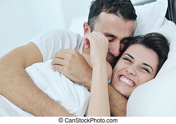 young couple have good time in their bedroom - happy young...