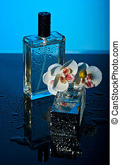 Perfumes and orchid - Two bottles perfumes with water drops...