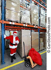 Santa claus checking wishing list of presents in storehouse