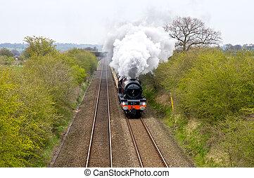 Steam Train - A Steam train traveling through the...