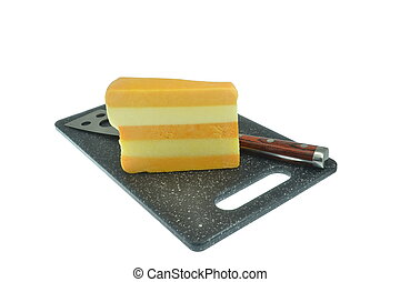 Block of cheese on stone
