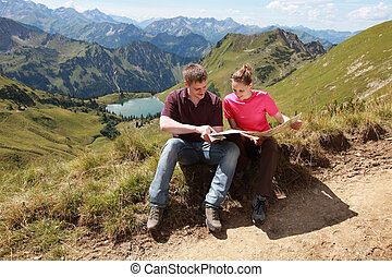 Hikers in the Alps - Male and female hikers in the German...
