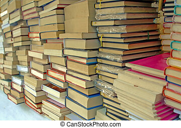 pile of old books for sale to the market