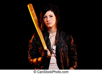 Young punk girl with baseball bat against black background