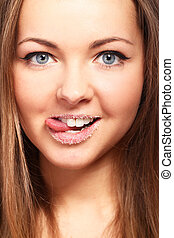 Potrait of woman with sugar on lips