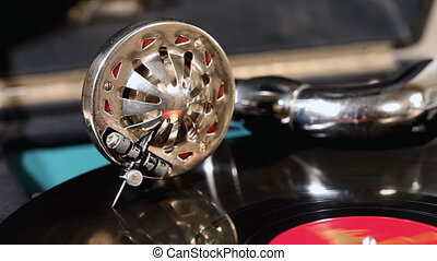 Vintage gramophone - An old gramophone playing a vinyl...