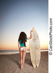Surfer Girl - Beautiful model wearing a white bikini and...