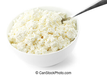 Cottage cheese with spoon in white bowl isolated on white...