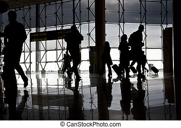 Silhouette of airport travellers
