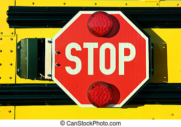 Red Stop Sign on Yellow School Bus - Close up of red stop...