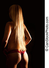 Beautiful back of nude blond woman with wet body